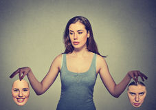 Beautiful girl holds two masks Stock Photos