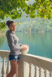Beautiful Girl in a hoodie. Mountain blue lake green. Beautiful Girl in a hoodie. Mountain blue lake green Stock Photos