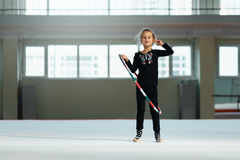 Beautiful girl with  hoop of rhythmic gymnastics. Royalty Free Stock Images