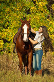 Beautiful girl with a horse Stock Photos