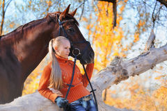 Beautiful girl with horse in autumn forest Royalty Free Stock Images