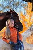 Beautiful girl with horse in autumn forest Stock Image