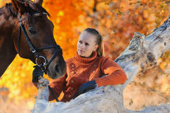 Beautiful girl with horse in autumn forest Royalty Free Stock Image