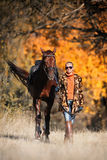 Beautiful girl with horse in autumn forest Royalty Free Stock Photography