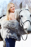 Beautiful girl with horse royalty free stock image