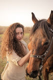 Beautiful girl with a horse outdoors Royalty Free Stock Photography