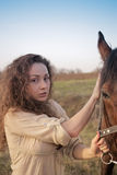 Beautiful girl with a horse outdoors Royalty Free Stock Images