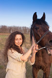 Beautiful girl with a horse outdoors. Stock Photo