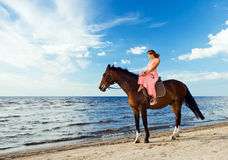 Beautiful girl  with horse on seacoast Stock Photography
