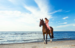Beautiful girl  with horse on seacoast Royalty Free Stock Photos