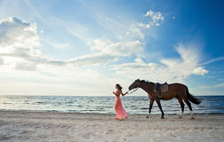 Beautiful girl  with horse on seacoast Stock Photos