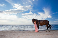 Beautiful girl with horse on seacoast Stock Photo