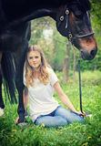 Beautiful girl and horse in spring garden Stock Photo