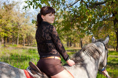 Beautiful girl on horse walk in woods Royalty Free Stock Photo
