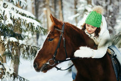 Beautiful girl and horse in winter Royalty Free Stock Photo