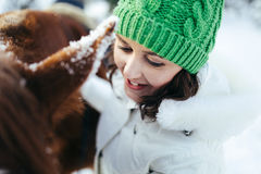 Beautiful girl and horse in winter Stock Image