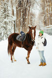 Beautiful girl and horse in winter Royalty Free Stock Photos