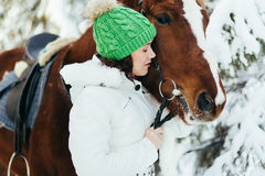 Beautiful girl and horse in winter Royalty Free Stock Image