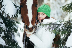 Beautiful girl and horse in winter Stock Photos
