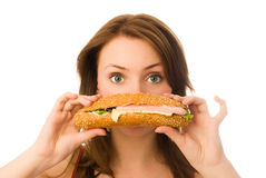 Beautiful girl with a hot-dog Royalty Free Stock Photo