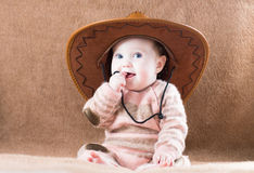 Beautiful  girl in a huge cowboy hat Stock Photos