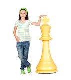 Beautiful girl with a huge piece of chess. Isolated on white background Royalty Free Stock Image