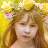 Beautiful girl hugging a bouquet Stock Photography