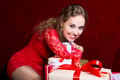 Beautiful girl hugging gift hand and smiling. Royalty Free Stock Photo