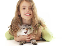 Beautiful girl hugging her cat. Royalty Free Stock Photos