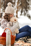 Beautiful,cute,nice,pretty girl with hat,nice,warm sweater hug soft,little,fluffy toy,white,beige teddy bear in winter cold forest Royalty Free Stock Image