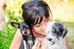 Beautiful girl hugging two little dogs Royalty Free Stock Photos