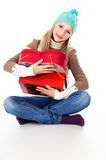Beautiful girl hugs gifts in winter clothes isolated Stock Photos