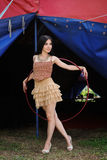 Beautiful girl with hula hoop in designer dress Royalty Free Stock Photography