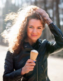 Beautiful girl with ice cream on   street. Royalty Free Stock Photography