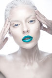 Beautiful girl in the image of albino with blue lips and white eyes. Art beauty face. Picture taken in the studio on a white background stock photos