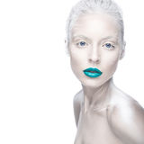 Beautiful girl in the image of albino with blue lips and white eyes. Art beauty face. Picture taken in the studio on a white background Stock Images