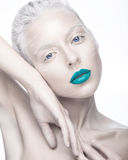 Beautiful girl in the image of albino with blue lips and white eyes. Art beauty face. Royalty Free Stock Photo