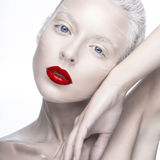 Beautiful girl in the image of albino with red lips and white eyes. Art beauty face. stock photos