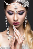 Beautiful girl in image of Arab bride with expensive jewelry, oriental make-up and bridal manicure. beauty face. Royalty Free Stock Photo