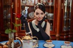 Beautiful girl at the image of Audrey Hepburn Royalty Free Stock Image