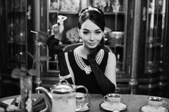 Beautiful girl at the image of Audrey Hepburn Stock Photos