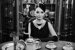 Beautiful girl at the image of Audrey Hepburn Royalty Free Stock Photo