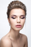 Beautiful girl in an image of bride with a bundle of hair and gentle makeup. Beauty face Royalty Free Stock Photography