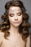 Beautiful girl in an image of bride with a diadem on her head. Beauty face. Photo was made in studio Royalty Free Stock Photos
