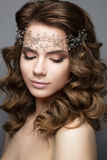 Beautiful girl in an image of bride with a diadem on her head. Beauty face. Photo was made in studio Royalty Free Stock Images