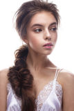 Beautiful girl in image of bride with plait. Model with nude makeup and silk underwear. Beauty face. Stock Images