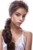 Beautiful girl in image of bride with plait. Model with nude makeup and silk underwear. Beauty face. Stock Image