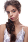 Beautiful girl in image of bride with plait. Model with nude makeup and silk underwear. Beauty face. Royalty Free Stock Images