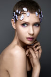 Beautiful girl in image of bride with а wreath of flowers on her head. Beauty face. Stock Photo