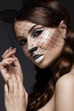 Beautiful girl in image of cat with art make-up and lace ears. beauty face. Stock Photos